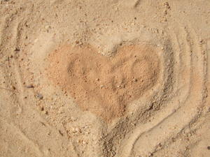 A heart build in the sand